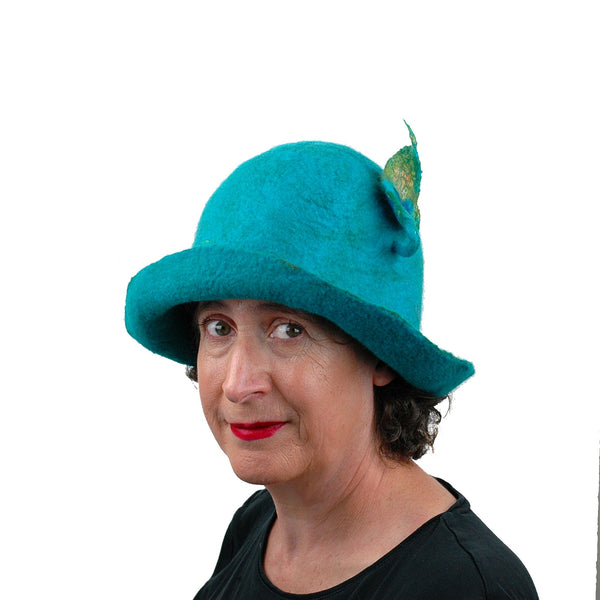 Felted Turquoise Blue Bowler with Stylized Peacock Feather - three quarters view