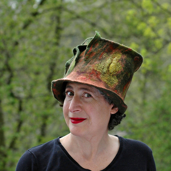 Green and Orange Felted Top Hat with Vertical Ruffles - against the trees