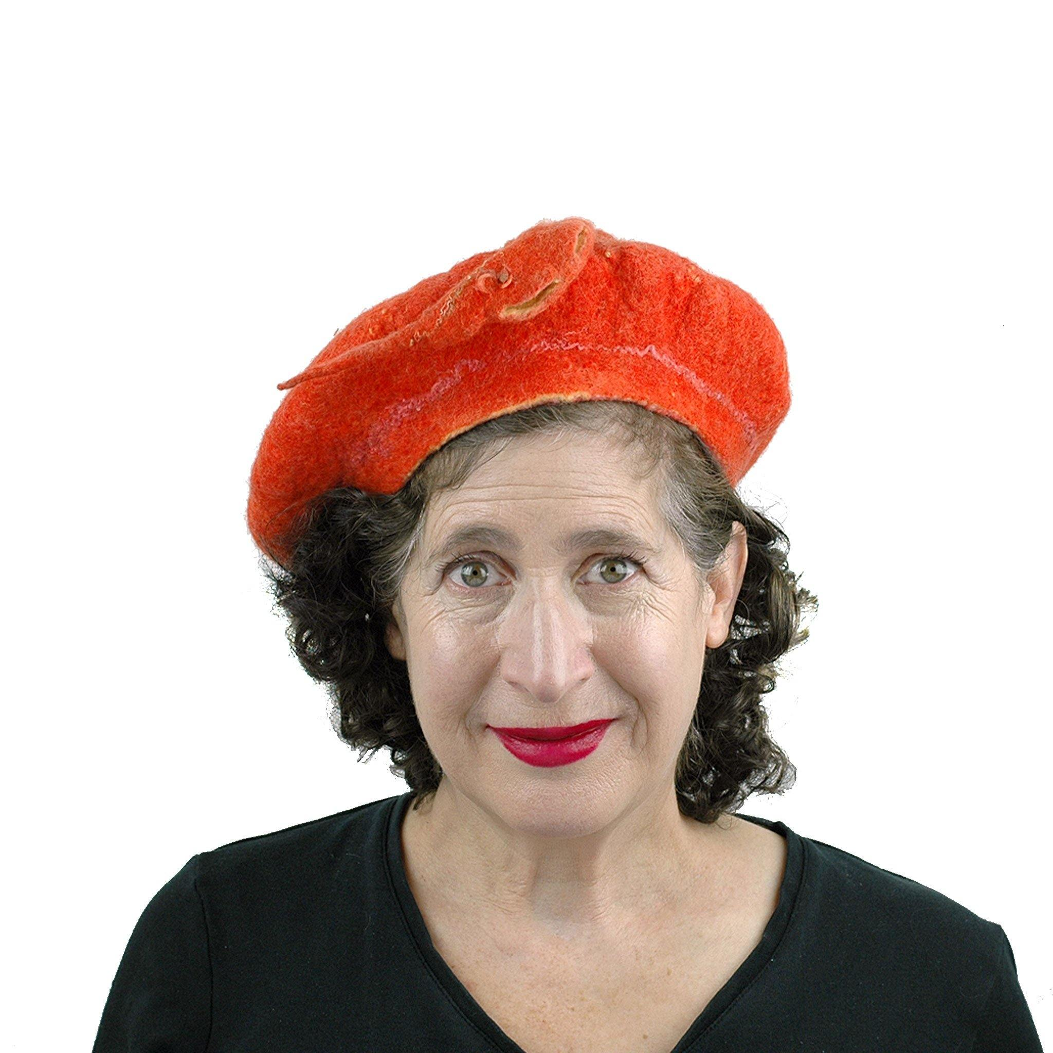 Orange Colored Beret with Felted Seed Pod - front view