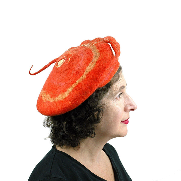 Orange Colored Beret with Felted Seed Pod - side view