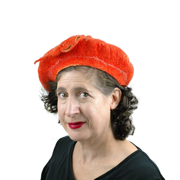 Orange Colored Beret with Felted Seed Pod - threequarters view