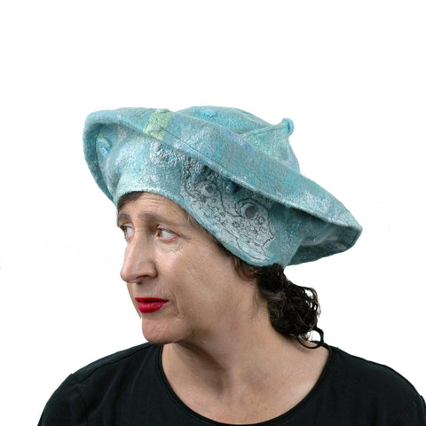 Seafoam Green Medieval Style Felted Hat that Covers Ears - three quarters view