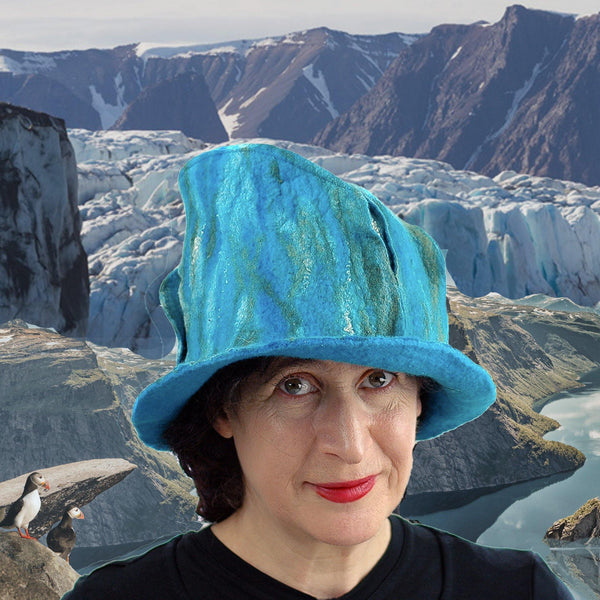 Turquoise blue and green felted fedora against Norwegian Fjords.