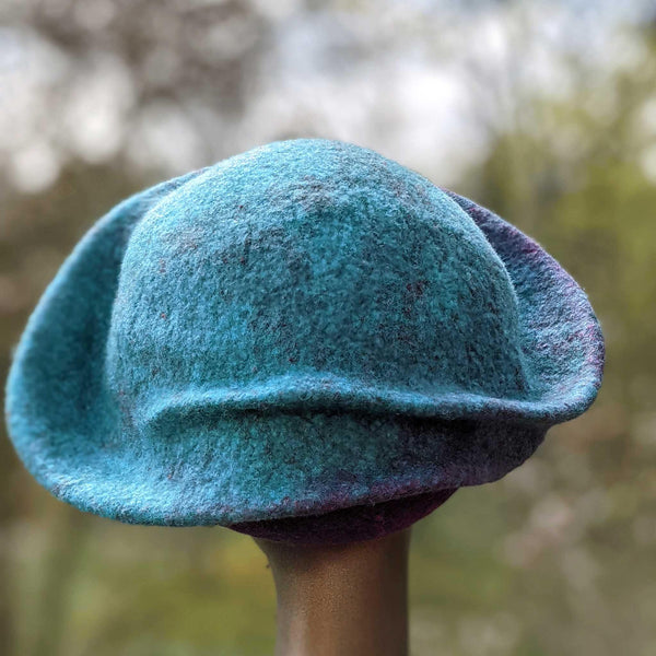 Undulating Spiral Hat in Blue-Green and Raspberry - back view