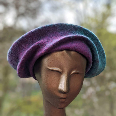 Undulating Spiral Hat in Blue-Green and Raspberry - front view