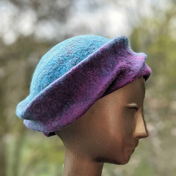 Undulating Spiral Hat in Blue-Green and Raspberry - side view