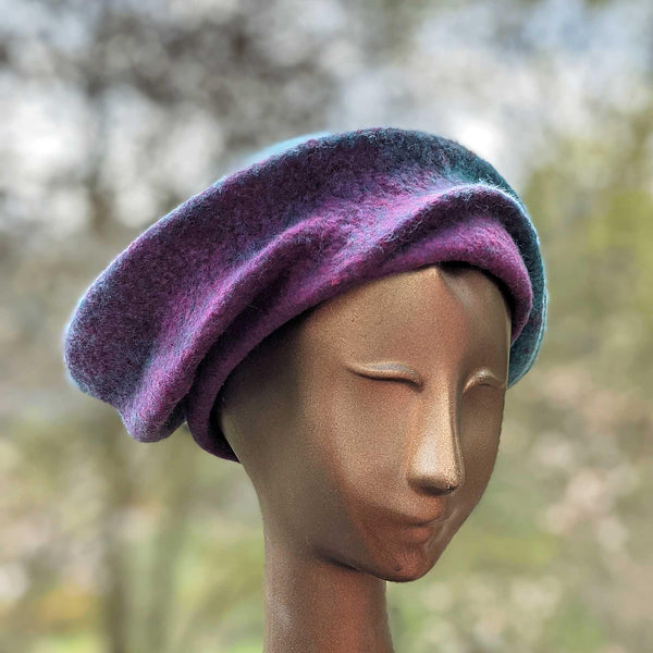 Undulating Spiral Hat in Blue-Green and Raspberry - threequarters view