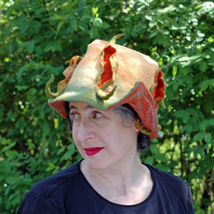 Unique Yellow and Orange Fedora with Three Peapods - against green shrubbery