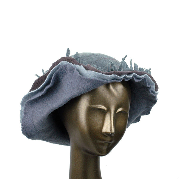 Wide Brimmed Felted Hat with Fringe in Neutral Colors - three quarters view