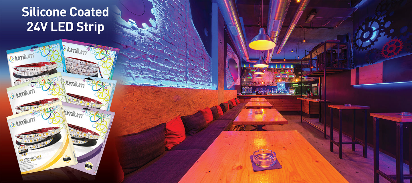 Club bar with brick wall and gears decor illuminated by Lumilum 24V Strip Lights, bar has multicolored sections and a colorful bar