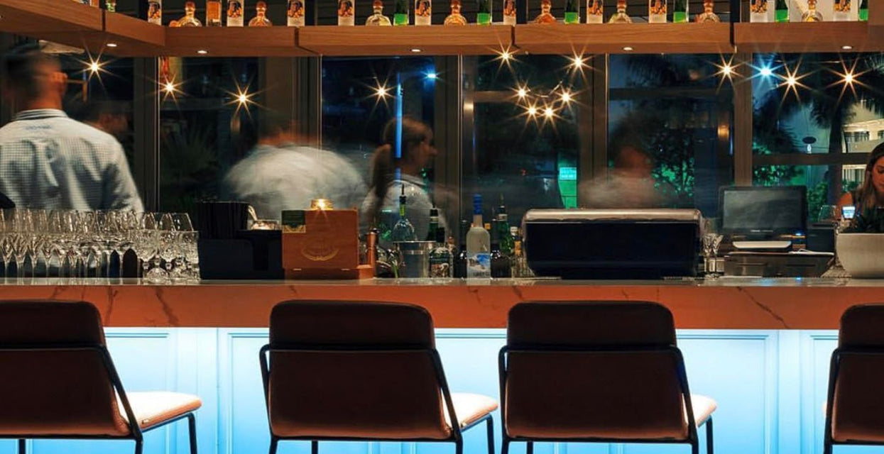 Bar illuminated with twinkling bottles and cool white light using Lumilum 120V Single Color LED Strip Light in 5500K