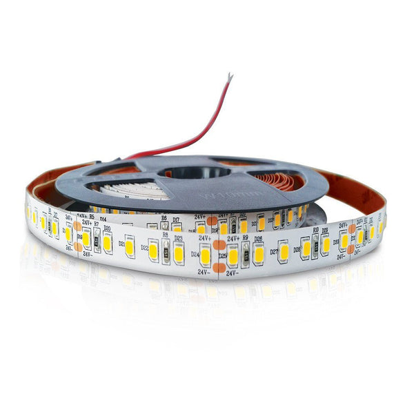led strip light with yellow led chips and red backing wound loosely with exposed red wire on black reel on white background