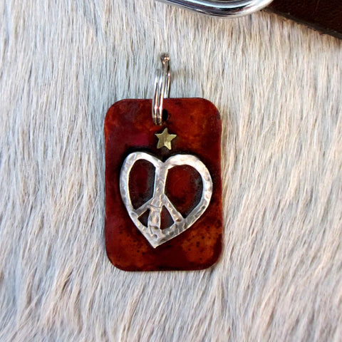 dog tag with heart shaped peace sign