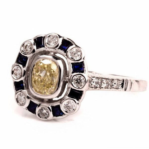 Fancy Yellow Cushion Cut Diamond with Diamond and Sapphire Halo in 14K White Gold