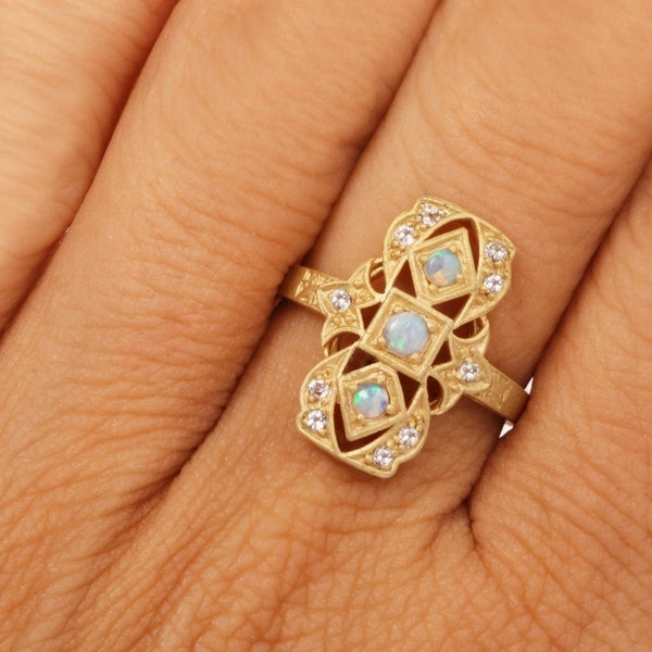 Goldtone Sterling Silver Opal and White Topaz Filigree Navette Ring