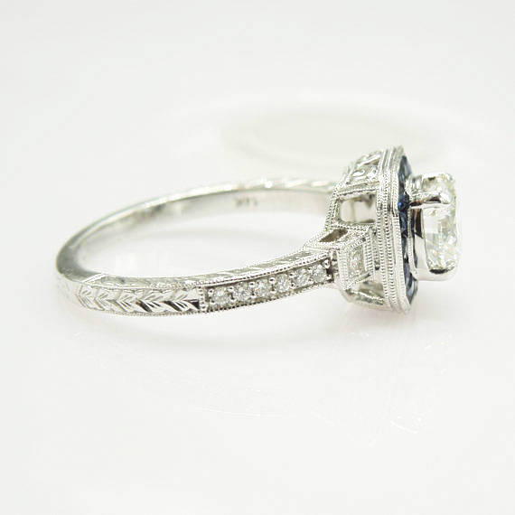 Art Deco Style Light Carat Diamond Ring with Sapphire Halo in White Gold
