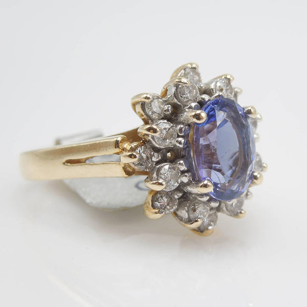 Oval Tanzanite in Yellow Gold with 1ct Diamond Cluster