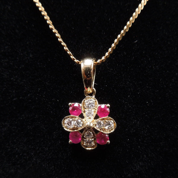 Yellow Gold Diamond and Ruby Flower Pendant