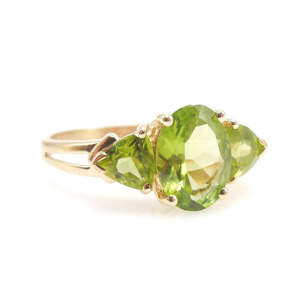Three Stone Peridot Ring with Oval and Trillions in 14K Yellow Gold