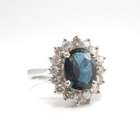 2+ct Deep Blue Sapphire in White Gold with a Surround of Diamonds