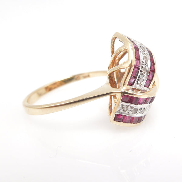 Large Ruby and Diamond Infinity Swirl Ring in Yellow Gold