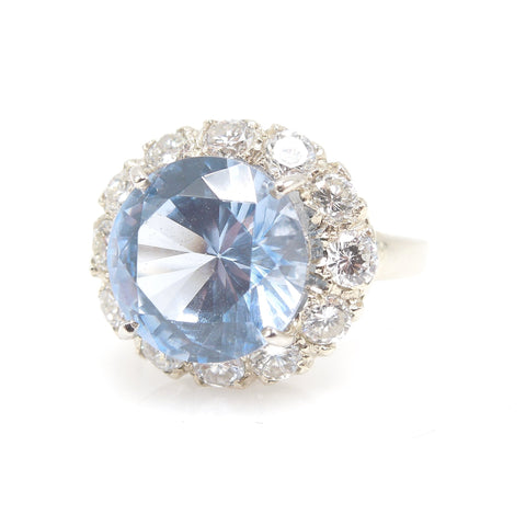 Large Round Blue Spinel Ring Surrounded by Diamond Halo in White Gold