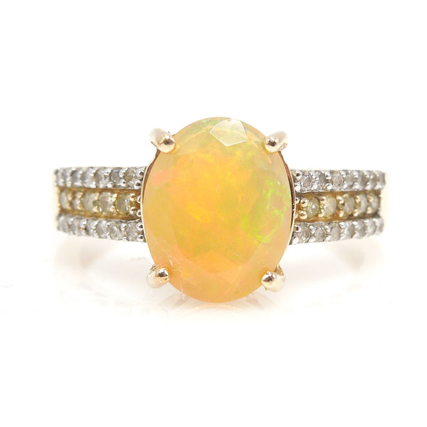 Faceted Fiery White Opal Ring with White Diamonds and Yellow Diamonds in Yellow Gold