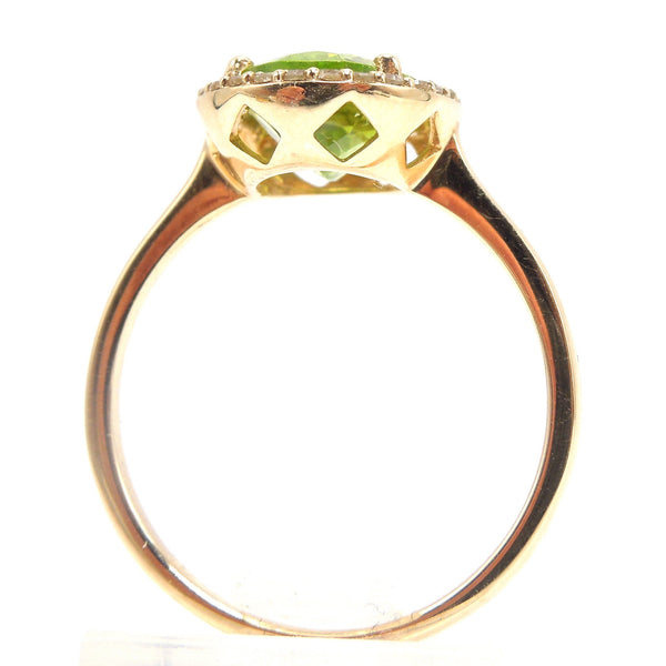 Large Oval Peridot Ring with Diamond Halo in Yellow Gold