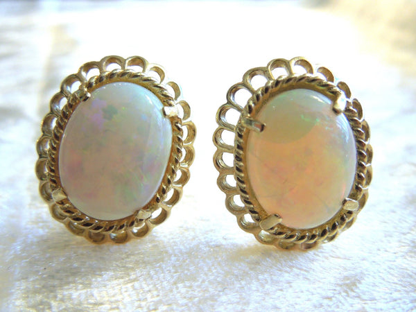 Oval White Opal in 14K Yellow Gold French Back Earrings
