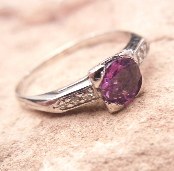 Purplish Pink Sapphire in Platinum Mounting with Diamonds