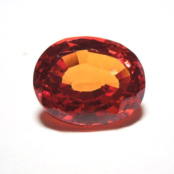 5.77 ct Rich Orange Red Oval Cut Sapphire