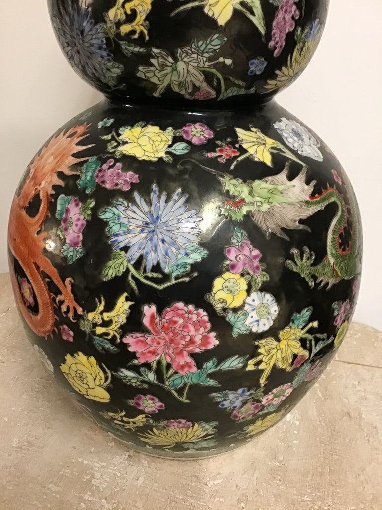 Chinese Black Vase with many multi colored items.