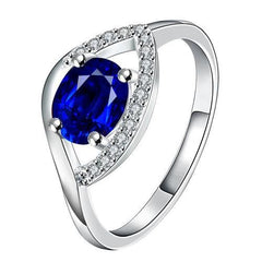 925 sterling silver filled Ladies engagement style ring with tanzanite color Crystal