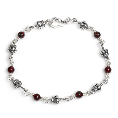 TINY CROWN BRACELET w/ GARNET