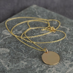 long gold disc pendant