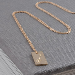 arrow engraved gold necklace