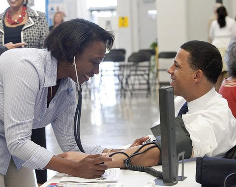 Medical Facility Doctor Takes Patient's Blood Pressure