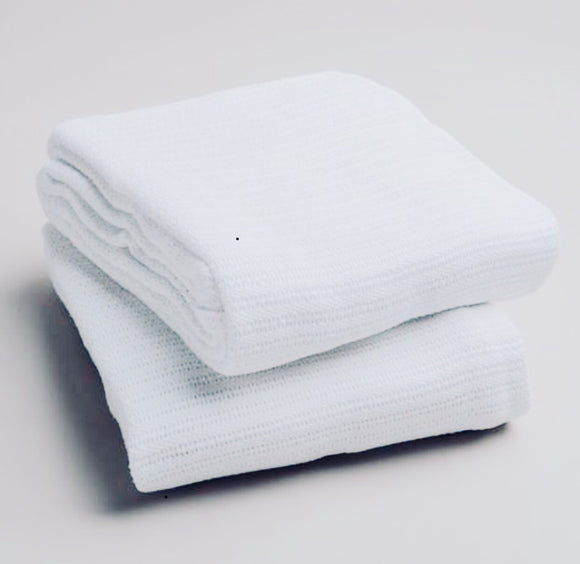 The cotton thermal blanket is preferred on the treatment table.  It's light weight makes it easy for draping but still keeps the client cozy and warm.  The open weave keeps the blanket breathable.  It has also been called the hospital blanket.   72x90