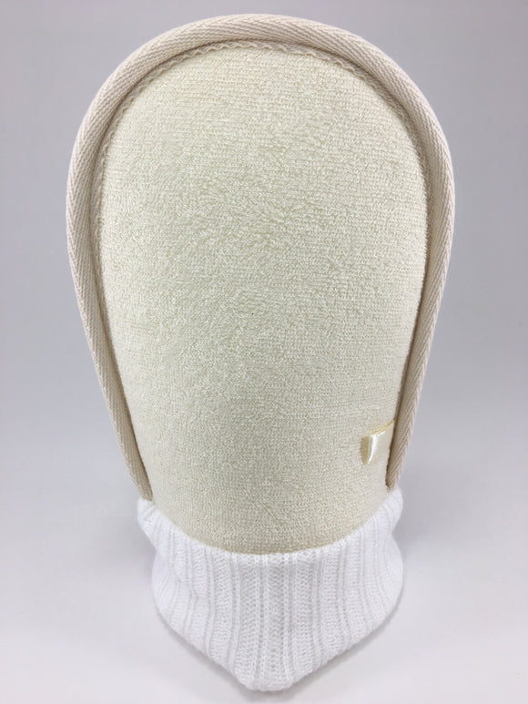 Our loofah mitt is made from natural materials.  There are two sides, a softer side made of terry and the other is rough for exfoliating,  but still gentle enough for sensitive skin.  It takes away dead skin cells leaving the skin smooth and soft.