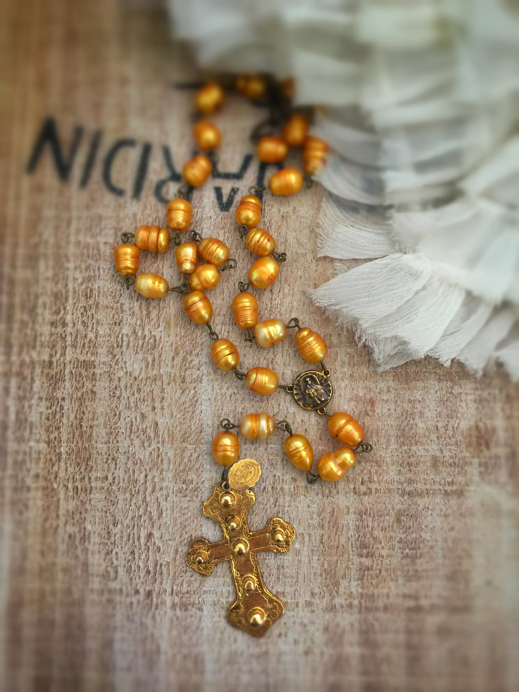 Saint Eve Golden pearl Rosary Necklace
