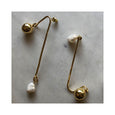 Saqui Studio Asymmetric Pearl Stud Earrings