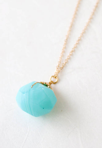 blue stone necklace on gold chain