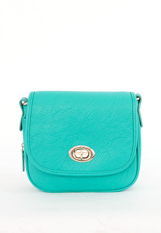 teal green purse with orange bottom
