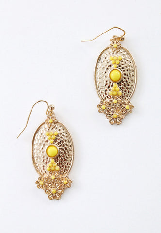 hammered gold earrings with yellow flowers