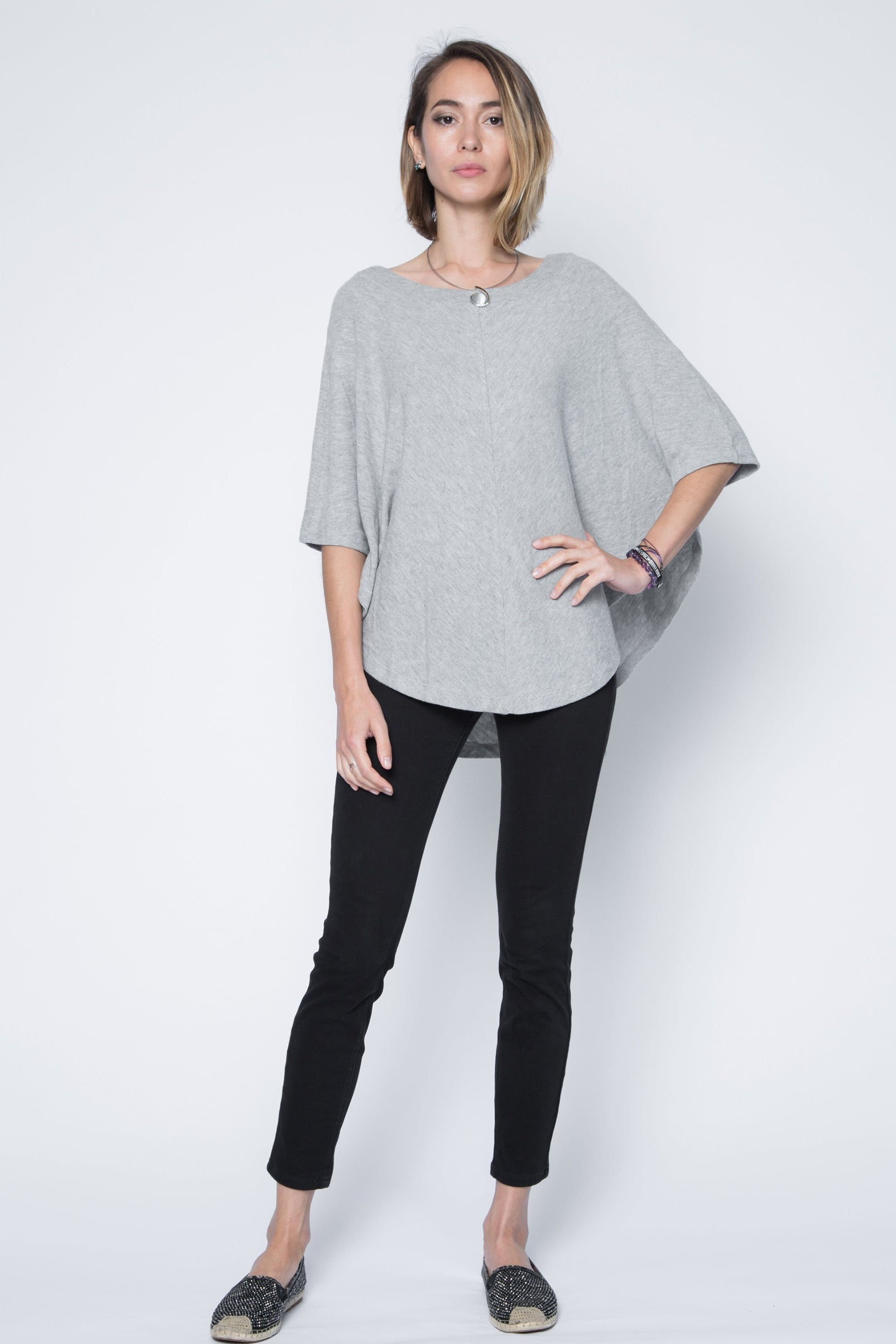 One size kimono sleeve poncho sweater in light grey.