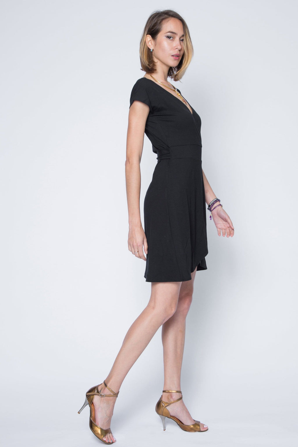 Cap sleeve black jersey wrap dress.