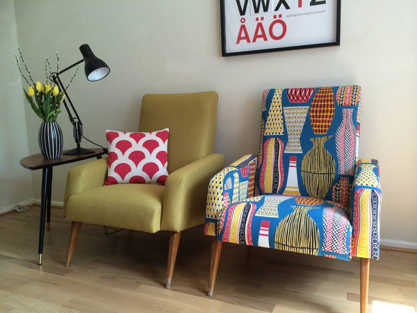 A pair of mid century French club chairs reupholstered in mustard wool and Sanderson Hayward fabric