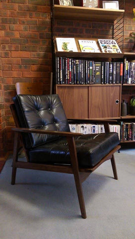 vintage mid century Danish armchair given new cushions in a soft black analine leather