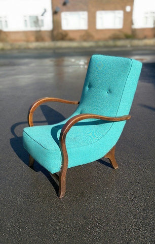 Vintage armchair reupholstered in turquoise Designers Guild fabric