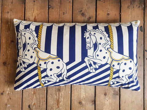 Cushion made from a delightful fabric featuring carousel horses